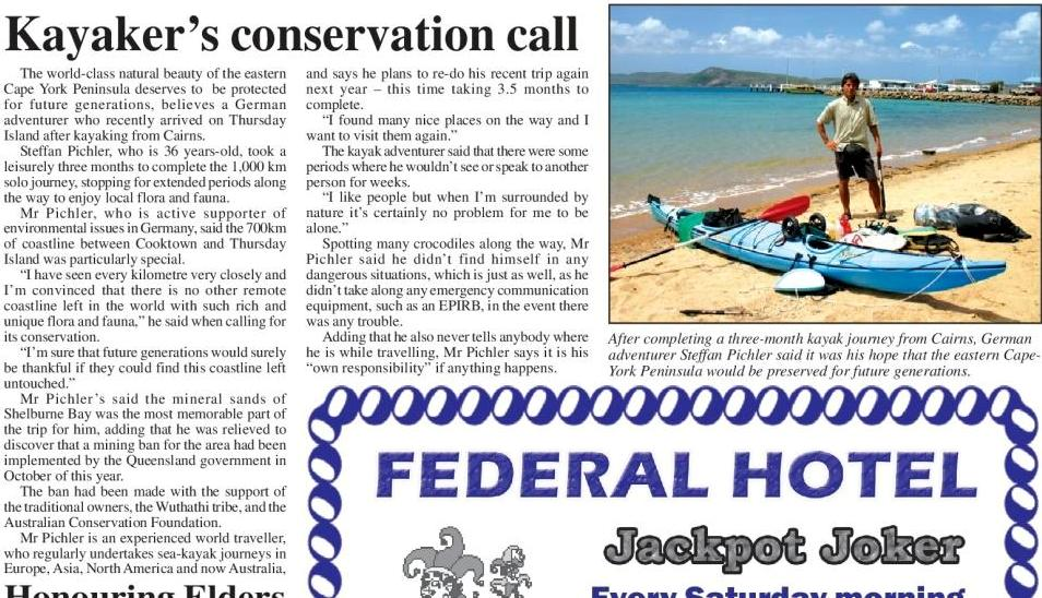 "Newspaper article of the ""Torres News"". Headline ""Kayakers conservation call"" with a picture of the kayak just beeing unpacked by the author Steffen Pichler after the arrival on Thursday island."